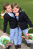 Dr. Huger's twin boys pose with Easter baskets
