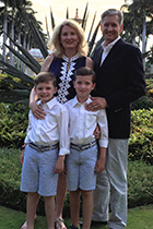 Dr. Huger smiles with her husband and twin boys